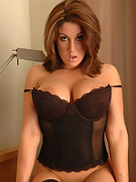 Krissy is poping out of her corset
