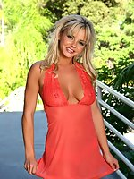 Bree Olson looks marvelous in her sheer coral dress