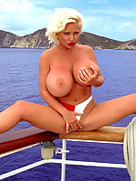 Blonde sports huge tits while sailing