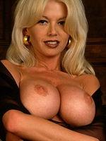 Carolyn Monroe busty blonde in black stockings