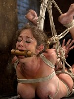 Felony busty milf is bound in hogtie suspension