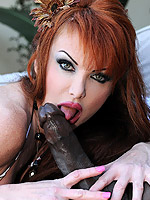 Taylor Wane busty redhead gets banged by a huge black dome