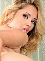 Lenka Gaborova in stockings uses a dildo