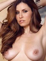 Jamie Lynn busty beauty spreads nude on bed