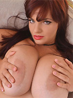Joanna Bliss with huge melons pose in lingerie and stockings