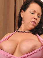 Angelica Sin bigboobs mom in pink dress strips in armchair